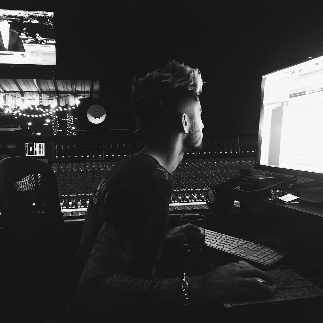 Zayn uses composing suite with monitor in peripheral vision.